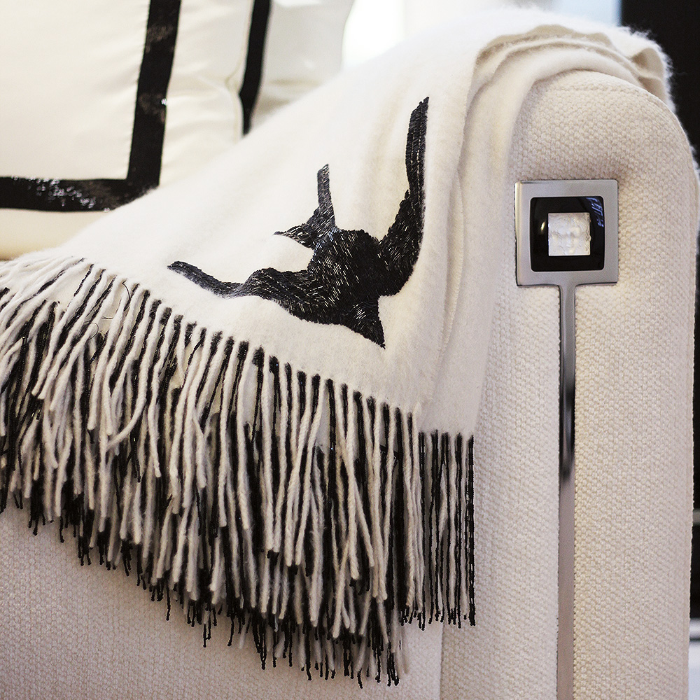 Hirondelles beaded cashmere throw | Ivory or black cashmere, black glass beads | Interior Design Lalique